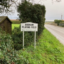 Bodham Playing Field sign on road, Bodham, North Norfolk, UK